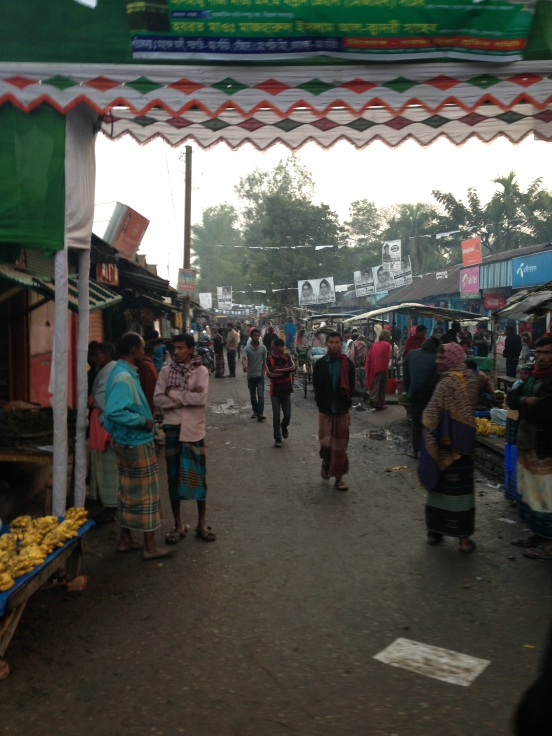 locals of sylhet in their normal wearing clothes. Long-sleeved shirts usually paired with their traditional lungi (similar to kilt) or trousers.